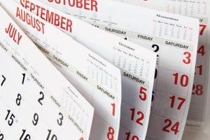 flipping through calendar