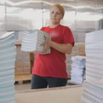 Female Worker Stacking Paper
